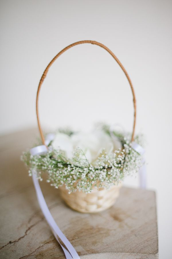 Flower Girl Basket with Babys Breath, but with the same ribbon as her dress and my dress