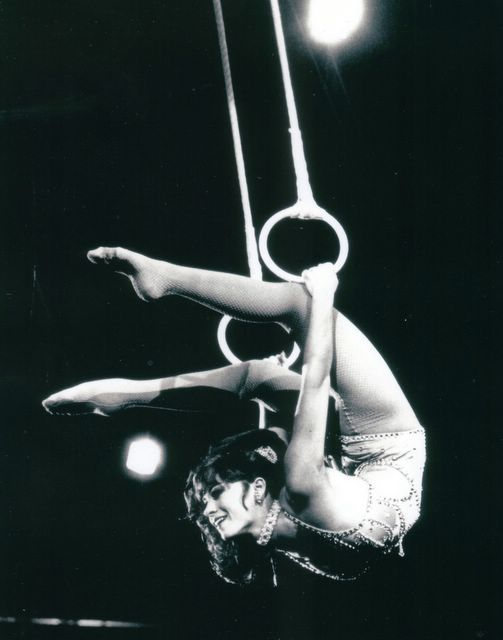 """""""Lovely DOLLY JACOBS, winner of two special awards at the International Circus Festival of Monte Carlo, performs on the Roman rings in the 109th Edition of Ringling Bros. and Barnum & Bailey Circus."""""""