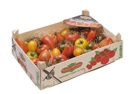 mixed tomatoes in wooden packaging
