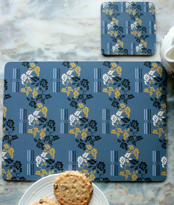 """""""Dentil"""" Design Placemats (4 for £25) & Coasters (4 for £12).  The ideal accessory to bring colour and pattern to your kitchen or dining table.  Made in England, this set of 4 heat resistant, melamine mats feature original The Humble Cut potato printed artwork.  Heat resistant to 145ºC, wipe clean with a cork back. #placemats #coasters #vines"""