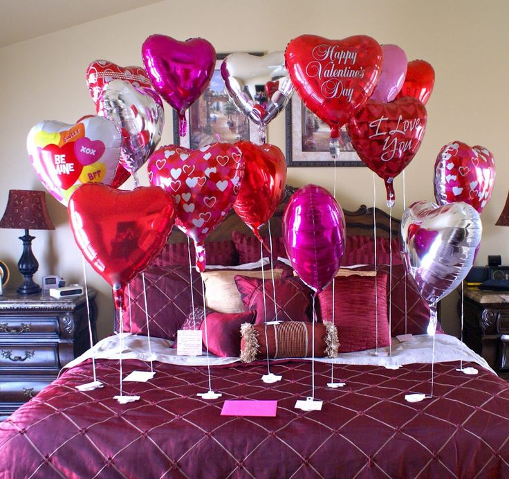 Decorate the bedroom for Valentines Day - and if you go to a Dollar Store these balloons are only $1 each. Not expensive at all and look at how great it looks! Bedroom, Charming Bedroom Decoration For Valentine's Day With Love Ballons Pink And Red Color Ideas