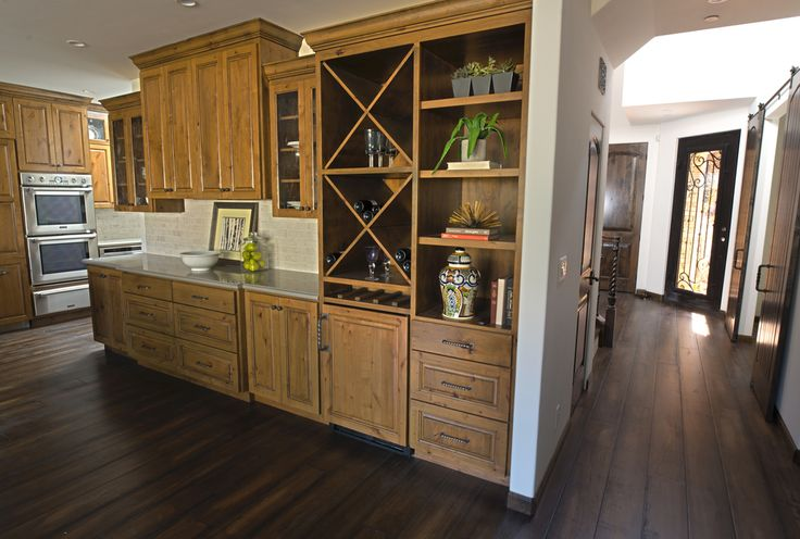 Custom Mediterranean luxury home in Menlo Park California with Knotty alder cabinets and wide plank hard wood floors, stained cabinets, rough stone counter tops and luxury electrical and pluming fixtures