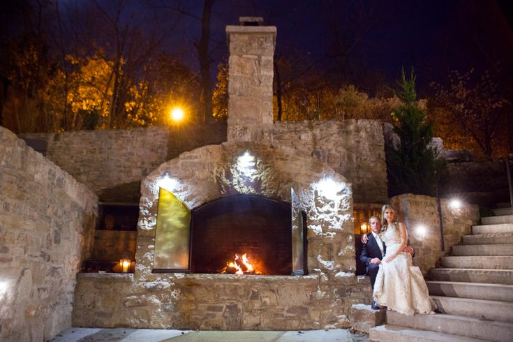 Ancaster Mill bride and groom beside outdoor fireplace