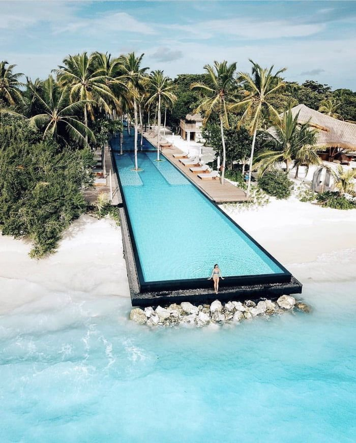 Enjoying an artificial pool by the ocean