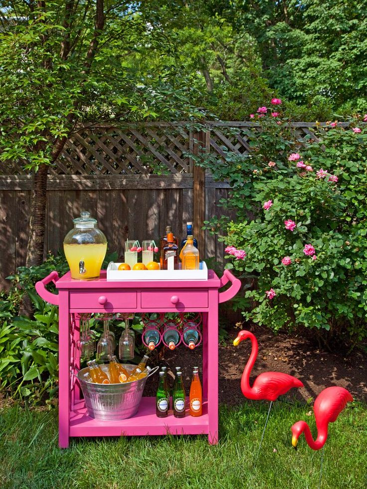 This backyard is ready for a summer soiree, complete with pink flamingos and colorful cocktails. Cool, refreshing drinks are served in style with this fun, fucshia bar cart.