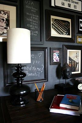 Framed chalkboard pieces add a touch of whimsy to a gallery wall in a home office.