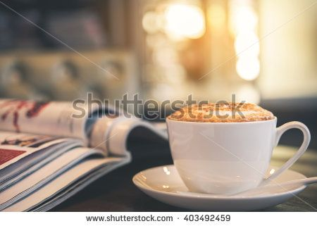 Cup of Latte in coffee shop background, vintage warm tone   - stock photo