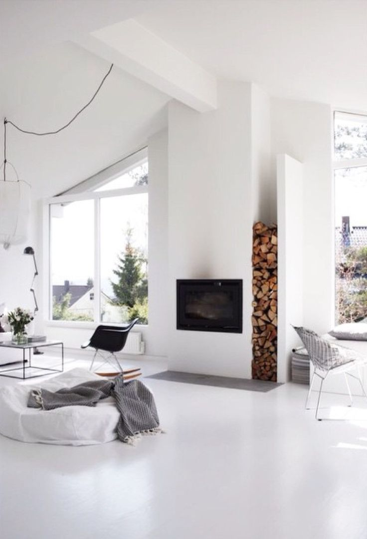 Put fireplace underneath TV? Black or White wall - all one color