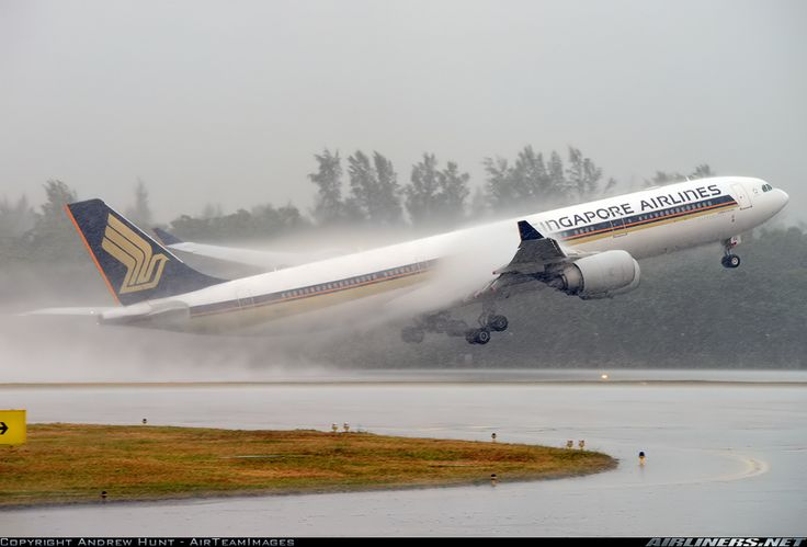 Singapore A340-541 roars off during  a huge storm! Great photo by  Andrew Hunt