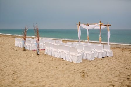Beach wedding in Crete with rustic branch decoration by MOMENTS www.weddingincrete.com