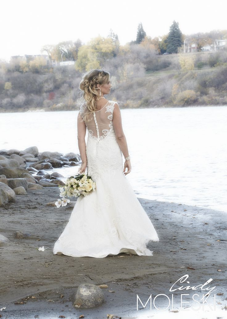 I prefer when brides wear their hair down and this is why - it looks good!  A relaxed portrait that shows off the back of her dress, her flowers and her hair.