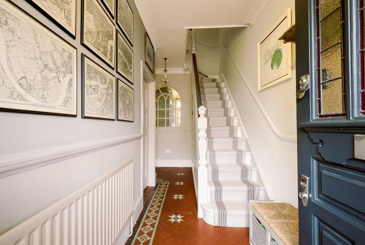 Townhouse hallway. Original tiles. Grid map made up with Victorian London map. Roger Oates runner. Talia Cobbold Interior Design.
