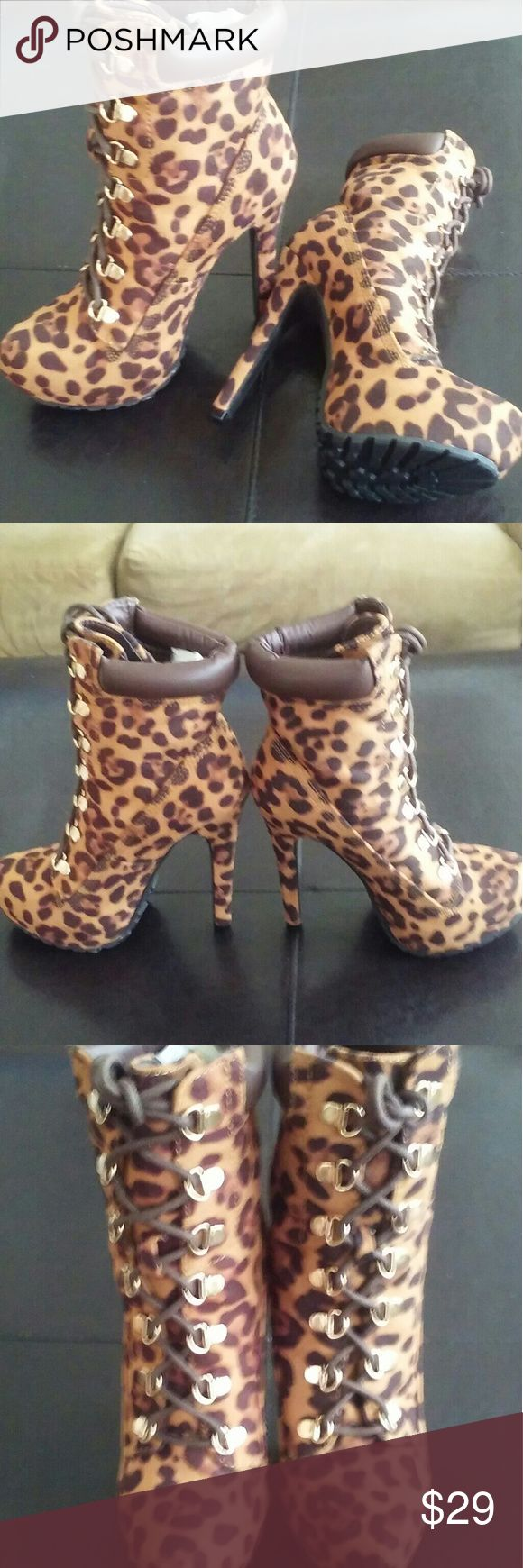 """Leopard Ankle boots Construction trend booties in faux suede / faux leather. The booties feature leopard print, sexy steep stiletto heel, animal print, gold hardware - D-rings, lace up clouser. Lug soles.   Details: heel 5-1/4"""", platform 1"""", the shoe runs narrow, high arch, will work for those who wear high heels regularly. New never worn. JustFab Shoes Ankle Boots & Booties"""