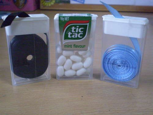 Ribbon dispenser from a Tic Tac container.