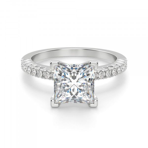 With its timeless elegance, it's no wonder this is one of our most popular engagement ring styles. The Contemporary Nexus Diamond™ center stone is the focal point, and the raised shoulders and slim accented band draw the eye back to the center stone. Even the chevron-inspired engraving on the profile suggests radiance. This light and airy design will never go out of style. Center stone is available in a variety of carat weights; choose yours from the menu above. Complete the look with the...