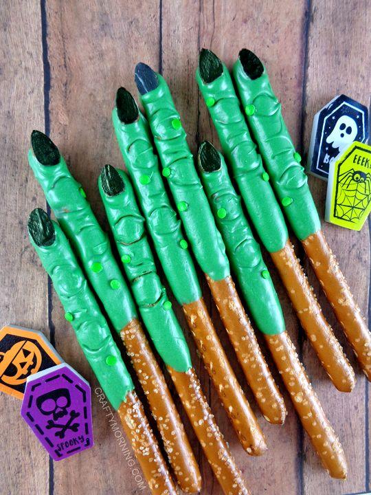 pretzel witch wart fingers! Ingredients: Pretzel Rods, Sliced Almonds, Black Food Dye, Green Candy Melts