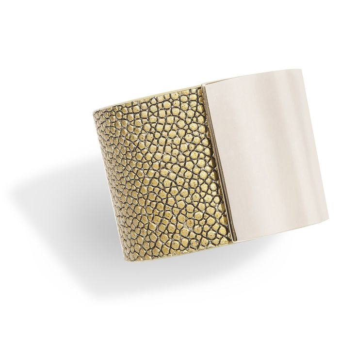 Momentum, a cuff bracelet in gold shagreen and gold-plated brass, hand crafted in a sleek and sophisticated design is the signature piece of De Galluchat.  #treasurethemoment #momentum #cuff #shagreen #degalluchat #galuchat #gold