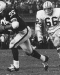 Oakland Raiders running back Hewitt Dixon, #35, is chased by Green Bay Packers linebacker Ray Nitschke, #66, during Super Bowl II, a 33-14 Packers victory on January 14, 1968, at the Orange Bowl in Miami, Florida (National Football League)
