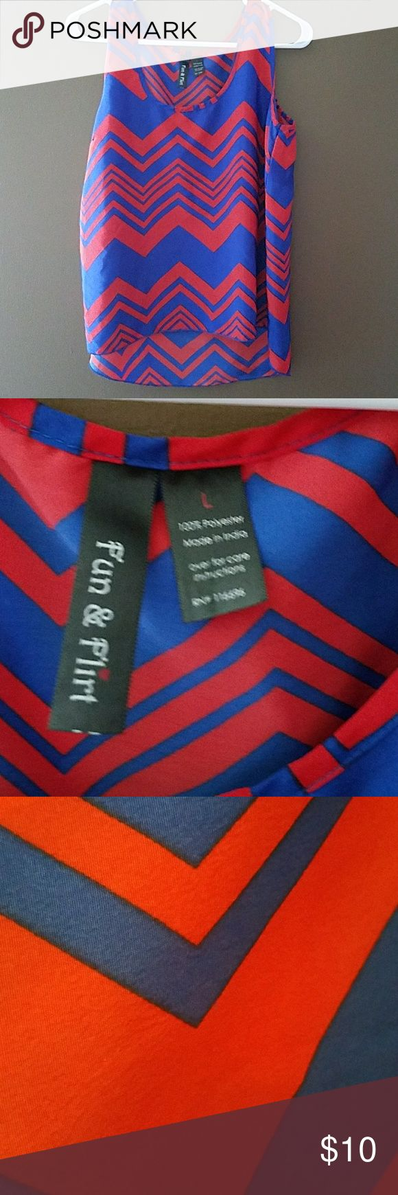 Beautiful blue and red chevron top Blouse like material with the back being slightly longer.  100% polyester fun and flirty Tops Tank Tops