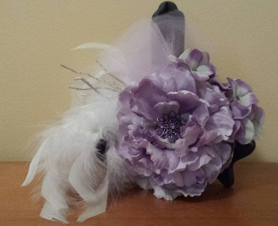 Mauve bridal fascinator with white and silver accents. Measures 8 by 9. Mounted on a 3.5 by 2 plastic haircomb. This piece is elegant and unique.