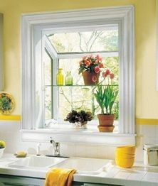 love the crown molding around the garden window and i love the bright yellow accents, would go great in a gray kitchen!
