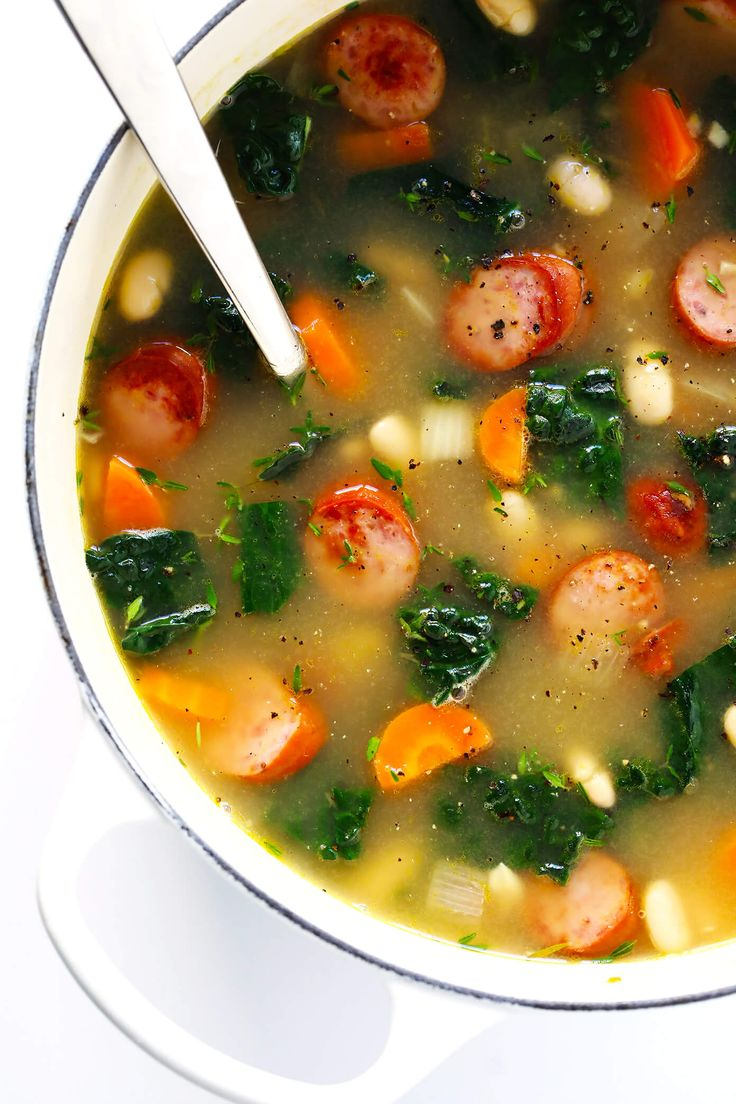 This Tuscan White Beans, Sausage and Kale Soup is one of my favorite winter dinner recipes. It's easy to make, full of cozy Italian flavors, and it's so warm and comforting.   Gimme Some Oven #souprecipe #healthysoup #italianrecipes