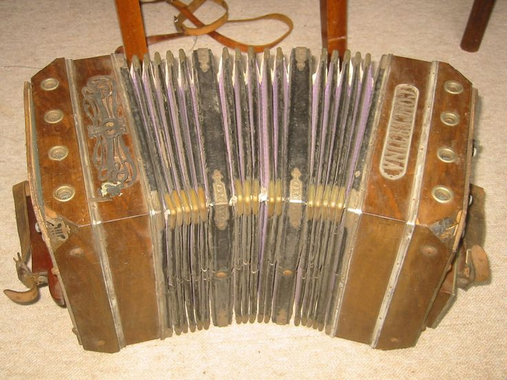 """Very old concertina or bandoneon?. it reads """"Reinhard Neubauer Concertina"""". The overall size is 14,5 ; 9 3/4 ; 9 1/4'. (37 /24,5/23,5cm). The instrument needs serious service and repair, maybe only for display. 