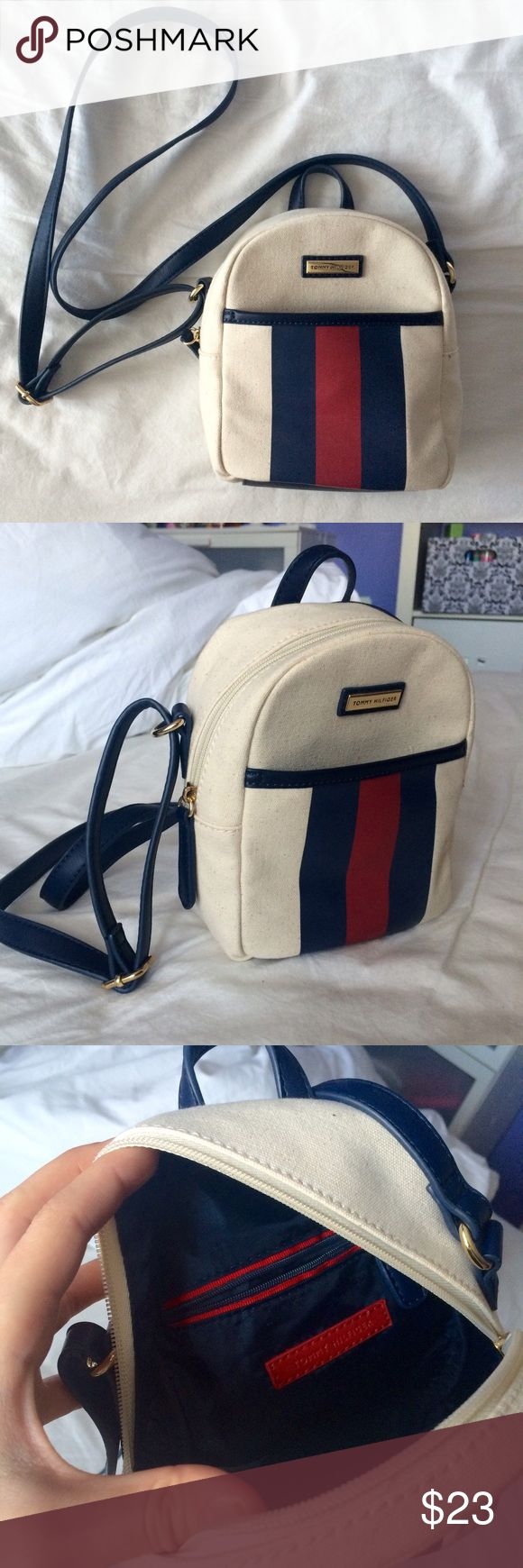 Tommy Hilfiger mini backpack inspired crossbody Cream colored. Mini backpack design. Crossbody. Super cute & never worn. Interior pocket. Classic Tommy navy & red stripe on front. Tommy Hilfiger Bags Crossbody Bags