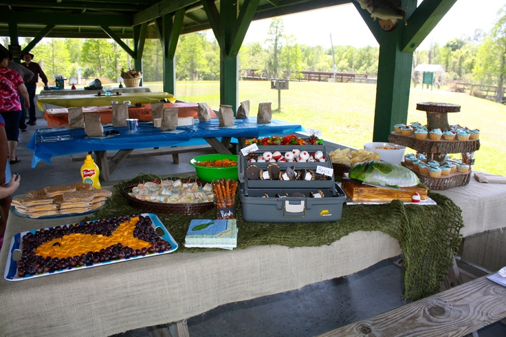 Fishing party food table- LOVE the cheese and grape fish and cookie reels!!