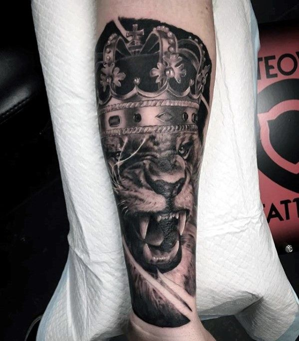 Lion With Crown Guys Forearm Tattoo Inspiration