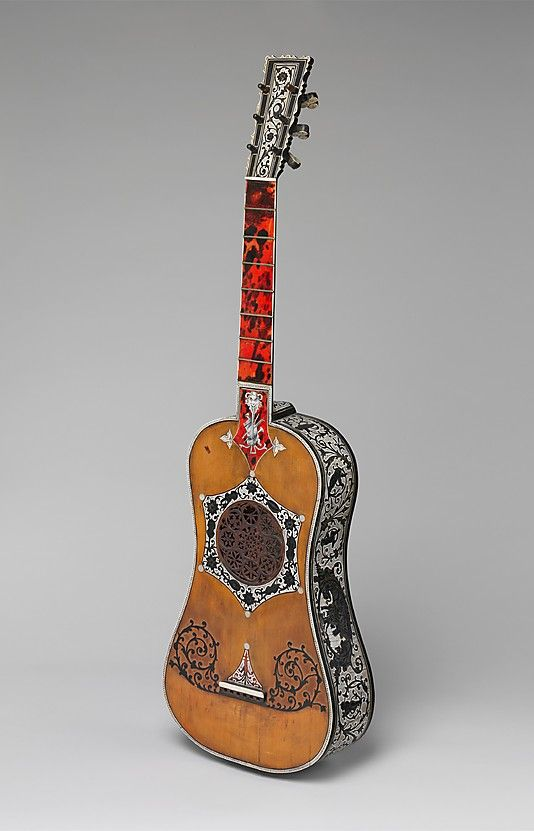 1800 Italian (Naples) Guitar at the Metropolitan Museum of Art, New York - This guitar is an exquisite-looking piece!  It's been decorated with ivory and ebony and it has a fingerboard made with tortoiseshell - an expensive piece indeed.  Click the pin to access more images - you have to see the back of this thing!