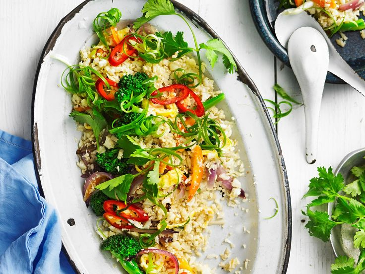 Ditch the carbs and opt for this delicious paleo version of 'fried rice'. We've used the versatile cauliflower to create a super healthy and deliciously satisfying dish.