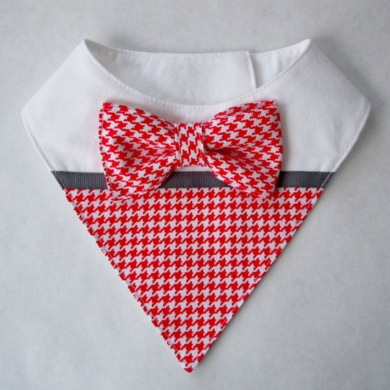 Bib-style bandana made in vibrant red and white mini houndstooth print, white Kona cotton, and pewter gray grosgrain ribbon. Closes in the back with velcro.  FEATURES... * Ideal for pets who are not used to wearing clothing. Easy to put on and comfortable for your pet to wear. * The bandana can drape in the front, side, or back. * Interfaced for structure and durability, yet soft and flexible. * Completely lined with cotton, with all seams enclosed. * The extra wide velcro is securely…