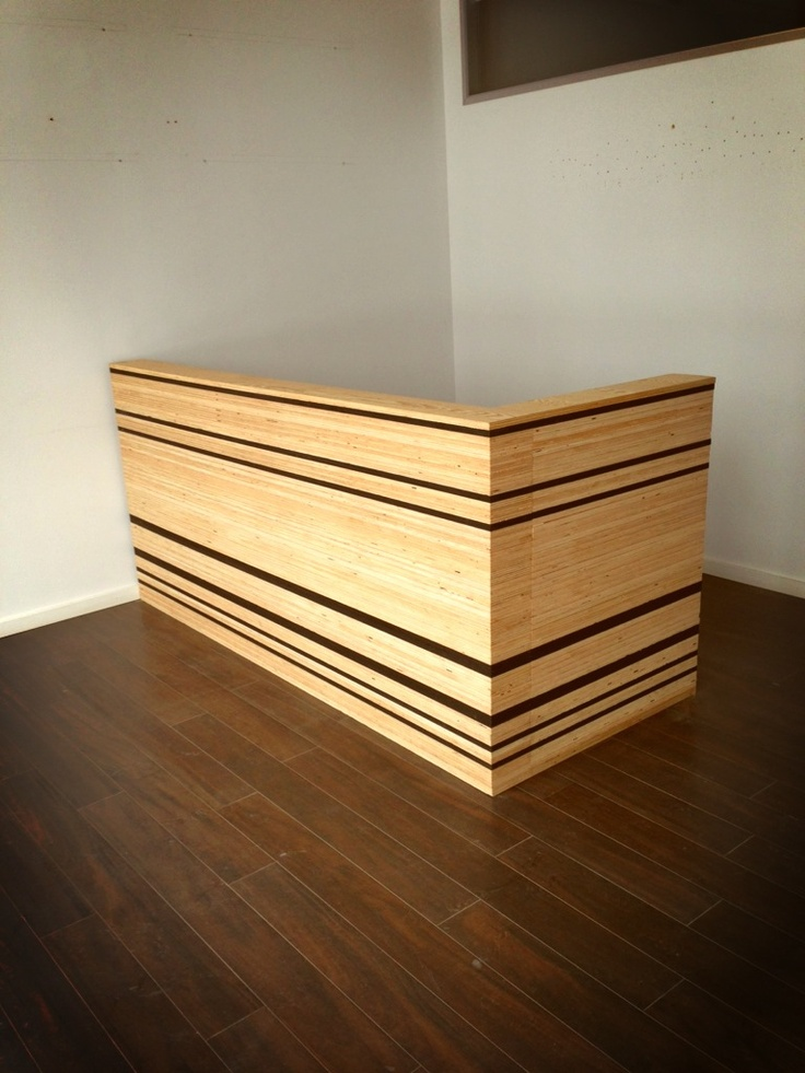 in progress construction photos: plywood reception desk designed