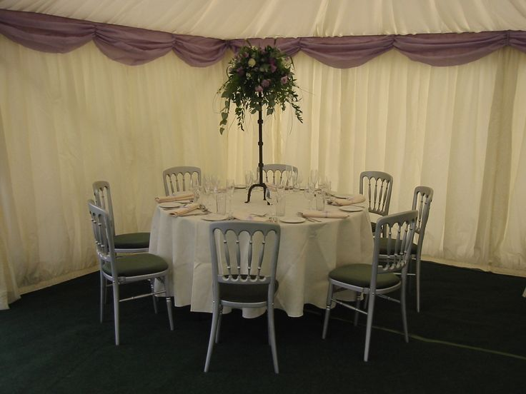 Silver chairs with green seat pads  http://www.richardsonmarquees.co.uk/