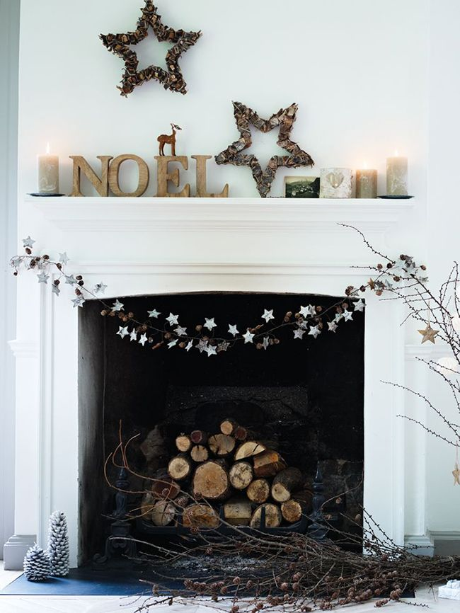 For fans of Scandinavian design and style simplicity, this Christmas mantlepiece arrangement hits the spot.