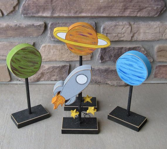 rocket ship and planet blocks on stands for space themed decor boy room decor