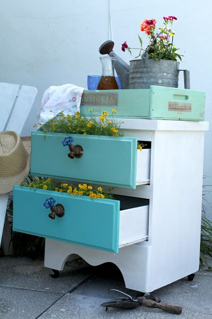 An adorable trash to treasure find, painted up and planted! Love the old spigot handles!