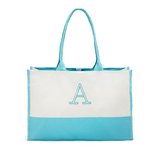 Cute, stylish and practical describes our Mila Initial Tote. Perfect for the beach, the market and to carry wedding must-haves to the ceremony, this versatile personalized tote bag boasts a roomy boxy fit to accommodate all your essentials.