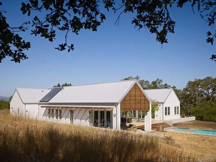 Simple farmhouse, 3 gabled buildings joined by glass hallways, centering a courtyard, with an infinity pool at the base. One for living, dining; one for children; one for parent's retreat.