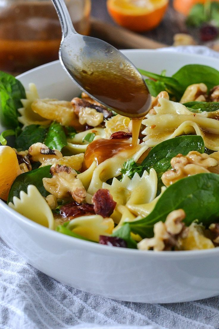 An easy recipe for Mandarin Orange and Spinach Pasta Salad loaded with goodness and topped with an easy 3 ingredient dressing!!