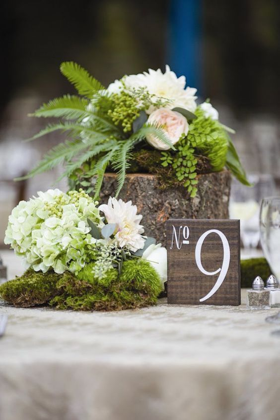 Gardenias, ranunculus, ferns and moss combined into a perfect enchanted forest centerpiece.