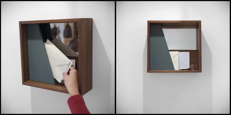 'Mirror Box C' in Walnut in by Alex Hellum for J+J - Apart from being a great graphic on a wall, the 'Mirror Box' is a place to leave the keys, display a postcard, hide a wallet (behind the colour panel) and do a quick reflection check before leaving the house. In oak or walnut with contrasting colour panel -   http://joinedandjointed.com/mirrors/mirrors/mirror-box-c-in-walnut.html