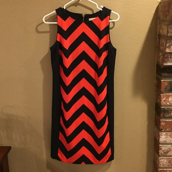 Micheal Kors orange and navy chevron dress. Perfect condition. Barely worn. Beautiful MK chevron design. Michael Kors Dresses Midi