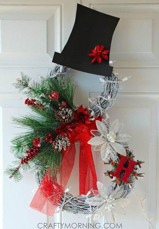 Here's an adorable Christmas wreath idea to make this year ~ a lighted grapevine snowman wreath! It is not very hard and looks great during the day and lighted at night! You can personalize it with any colors and monograms. Materials: 2 grape vine wreaths Pine branches White lights White Spray Paint Black Card Stock …