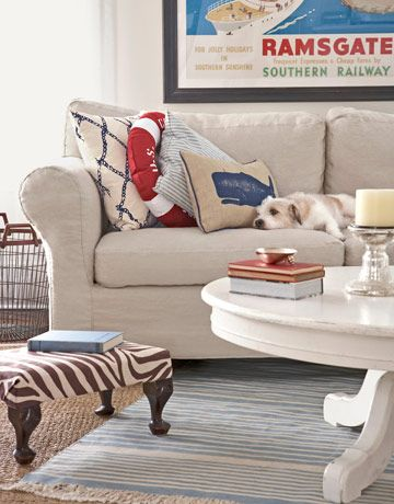 Nautical Living Room  A sofa slipcovered in linen gets some snap when piled with sailing-themed cushions (    Read more: Nautical Home Decor - Seaside Style - Country Living