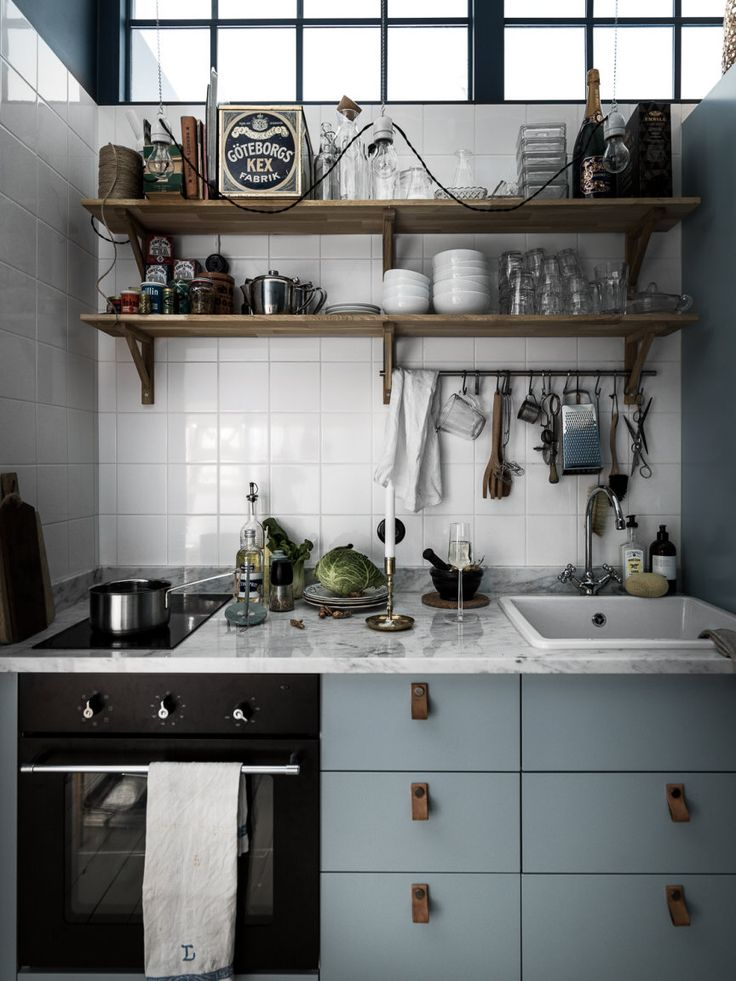 Open shelving is a great way to make the most of a small kitchen. Styled right, you can get a glam look in the tiniest of cook spaces.