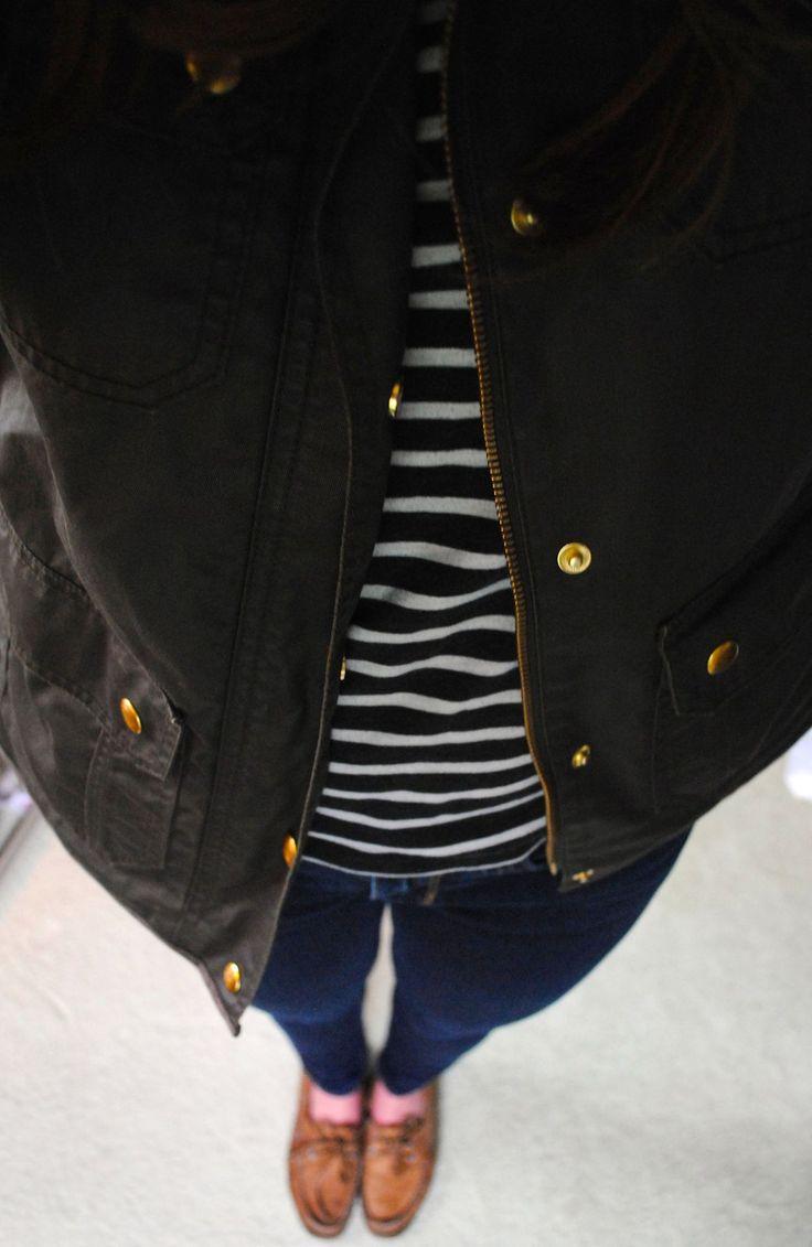 white striped black tee, dark skinny denim, dark olive jacket