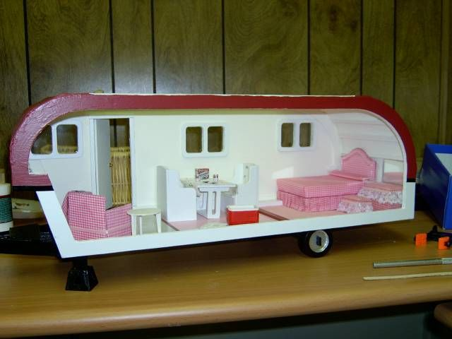Trailer doll house: I guess it can aid in setting realistic goals for you kids....