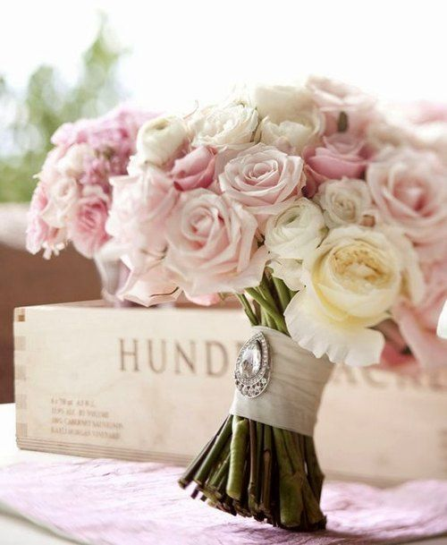 Lovely pink & cream roses wrapped and pinned with vintage brooch - wedding perfect!